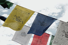 Tibetan Prayer Flags. A prayer flag is a colorful rectangular cloth, often found strung along mountain ridges and peaks high in the Himalayas. They are used to Royalty Free Stock Images