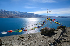 Tibetan prayer flags at lake Royalty Free Stock Images