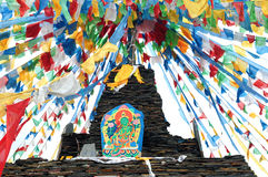 Tibetan prayer flags and mani rocks Royalty Free Stock Image
