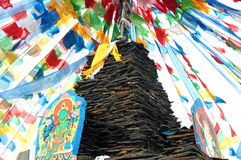 Tibetan prayer flags and mani rocks Royalty Free Stock Photography