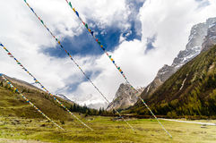 Tibetan Prayer Flags in mountain landscape of China Royalty Free Stock Photography