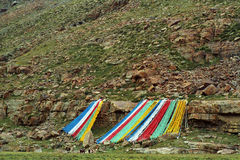 Tibetan prayer flags on the slope of Sacred Mount Kailash. Royalty Free Stock Photo