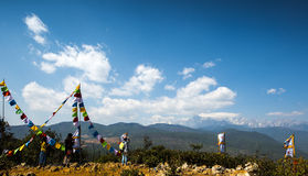 Tibetan prayer flags surround the snow mountain in Lijiang Royalty Free Stock Photography
