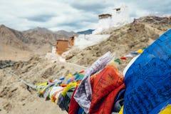 Tibetan prayer flags with Tsemo Monastery in Leh on background Stock Photography