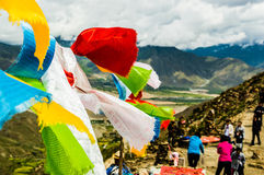 Tibetan prayer flags waving in the wind on a pass Royalty Free Stock Photo
