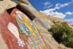 Tibetan prayer stone paintings in the mountains of Stock Photo