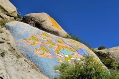 Tibetan prayer stone paintings in the mountains of Royalty Free Stock Photo