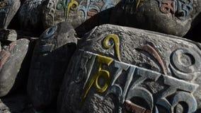 Tibetan prayer stone. stock video