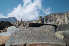 Tibetan prayer stones Stock Photo