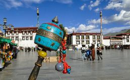 Tibetan prayer wheel. With cityscape background in Lhasa, Tibet Royalty Free Stock Images