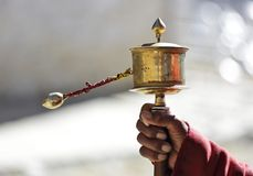 Tibetan Prayer wheel in the hand. Tibetan Prayer wheel or Mani wheel in the hand Stock Photo