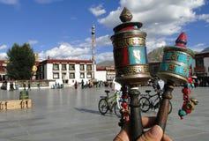 Tibetan prayer wheel. With cityscape background in Lhasa, Tibet Royalty Free Stock Photo