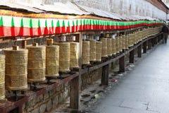 Tibetan prayer wheels. And flags, Lhasa, Tibet, China stock image