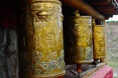 Tibetan prayer wheels stock images
