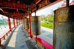 Tibetan prayer wheels. Tibetan Mani prayer wheels under a canopy in a Buddhist temple royalty free stock photos