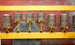 Tibetan prayer wheels in Boudhanath Stupa, Kathmandu, Nepal. Stock Photography