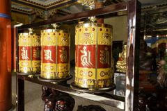 Tibetan prayer wheels at hohhot china lamesery Dazhou temple. These are unusually highly decorated prayer wheels at the Dazhou Lamesery in Hohhot, Inner Mongolia Stock Image