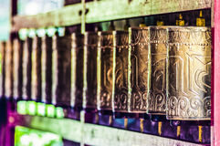 Tibetan prayer wheels in monastery in India. Stock Images