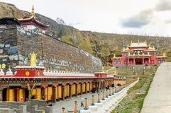 Tibetan Prayer Wheels and monastery stock photography