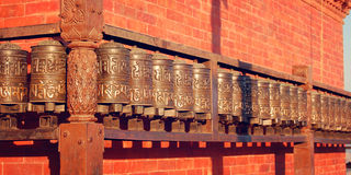 Tibetan Prayer Wheels near Swayambhunath Stupa - vintage photo. Stock Photo