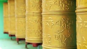 Tibetan praying wheels rotating in the monastery in Ladakh, India stock video