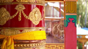 Tibetan praying wheels rotating in the monastery in Ladakh, India stock footage