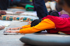 Tibetan Prostrating Outstretch Arms Flat Ground Stock Image
