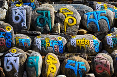 Tibetan religious budhist symbols on stones Royalty Free Stock Photos