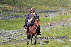 A tibetan rider. At A praying tibetan woman at Tibet Plateau Royalty Free Stock Images
