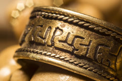 Tibetan Ring Macro. Handcrafted tibetan copper ring macro royalty free stock photos