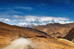 Tibetan road. Tibetan landscape with road and snowy mountains Stock Images