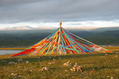 Tibetan's prayer flags(Jingfan) at sunrise Royalty Free Stock Photography