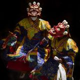 Tibetan sacral costumes Red Mahakals, the performance of Mask Dance by monks high tantric initiations on Buddhist festivals. Tibetan sacral costumes Red Stock Photo
