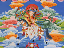 Tibetan Shangri-la mural. Colorful Tibetan mural depicting rider on horse in Shangri-la Stock Photography