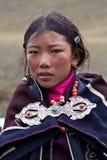 Tibetan shoolgirl. DHO TARAP, NEPAL - SEPTEMBER 11: Tibetan girl from Crystal mountain school posing for the photo during Full Moon Festival on September 11 Stock Image