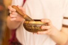 Tibetan singing bowl in hands. Buddhism concept Stock Image