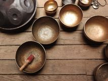 Tibetan singing bowl and other religious ritual instruments for meditation royalty free stock photography