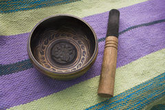 Tibetan singing bowl with stick top view Royalty Free Stock Photos