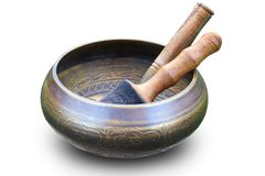 Singing Tibetan  Bowl with wooden mallets. Tibetan Singing Bowl with wooden mallets on a white background Royalty Free Stock Photography