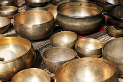 Tibetan singing bowls at a market. Tibetan singing bowls with batons for sale Stock Photo