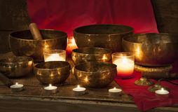 Tibetan singing bowls on red Stock Photo