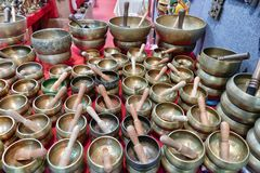 Tibetan singing bowls on sale in oriental fair royalty free stock photography