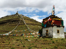 Tibetan Stupa At Hill Top With Prayer Flags Stock Photo