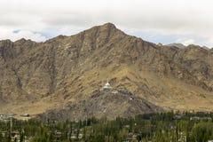 A Tibetan stupa on the mountain above the city stock photos