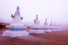 Tibetan stupas in heavy fog Royalty Free Stock Photo