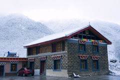 Tibetan-style Residence in snow Stock Image