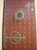 Tibetan Temple door detail. Detail of a Tibetan Temple door with iron ornaments Stock Photography