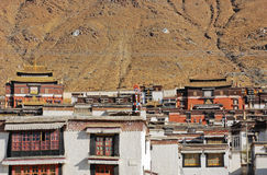 Tibetan temple with mountain background Royalty Free Stock Photo