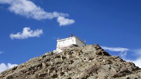 A Tibetan temple on a rock under a blue sky. Tibetan temple on a rock under a blue sky stock video footage
