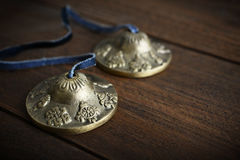 Tibetan Ting Sha Ceremonial Bells. On wooden background closeup Stock Photos